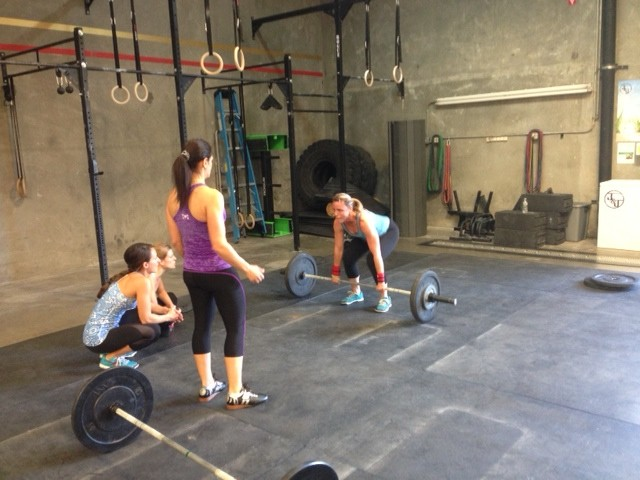 The girls pushing Shannon at the end of the WOD