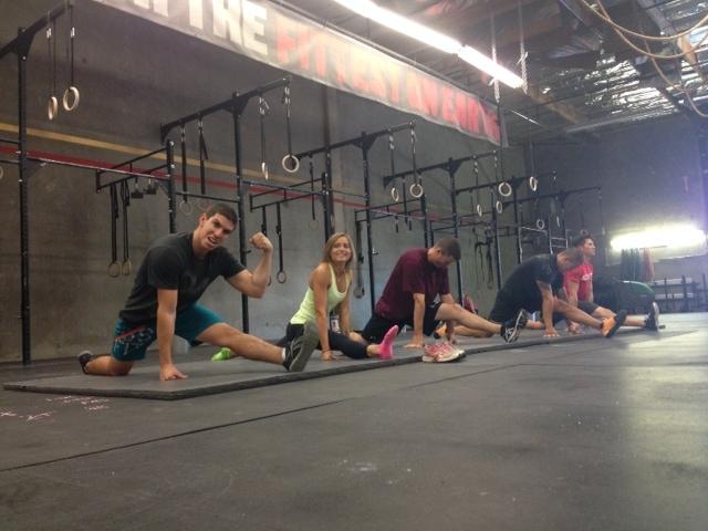 Gymnastics class working on their splits