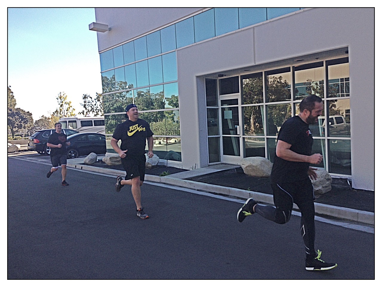 Mike, Chris and Duncan race to the finish on the last round of Mondays 200 meter repeats