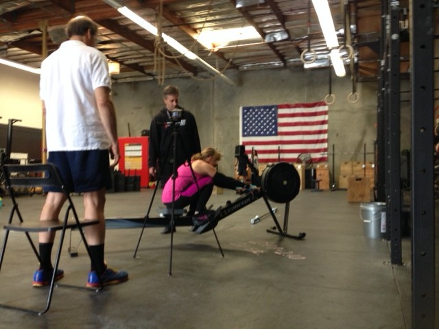 "Art closely watching Polly as she takes down the masters 60+ Regional WOD, ""Double Jackie"""
